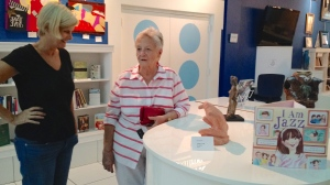 Coral Gables visitor up for the Art Opening speaking to Artists Sue Fisher